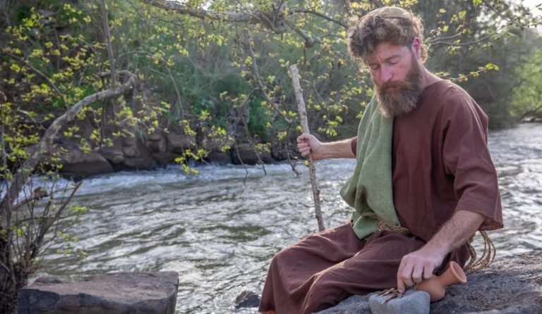 John seats next to the river